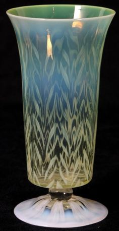 Tiffany Favrile Pastel Feathered Vase. Has a round foot with opalescent vertical stripes, clear glass spherical stem and a yellow cup shaded with opal glass and a pulled feather opalescent pattern. Etched signature and in excellent condition. 6.5 in. High