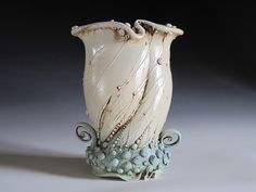 Vase by Carol Long (this very one sits on a shelf between my living and dining rooms).