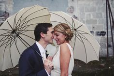Couples with umbrellas are lovely.
