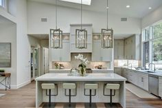 White Open Plan Transitional Kitchen With High Ceilings