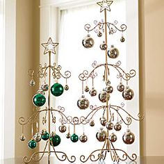 So I could display my ornaments without bothering with a real tree .