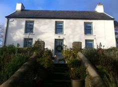 The simple and beautiful farmhouse facade.The White House, Durrus.