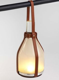 'Objets Nomades' by Louis Vuitton - Solar-powered bell Lamp by Barber Osgerby.