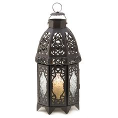 Magical patterns haunt the night cast by the intricate panels of this stunning Moroccan marketplace lantern. Adds an instant touch of the exotic to everyday life! Weight 1.2 lbs. Iron and glass. Candl