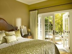 """One Tone — Not One Note Sticking with a single color should feel lush, not stingy. Designer Sarah Barnard dressed this room entirely in green to echo the verdant plantings just outside the French doors. Still, the effect is subtle because of layered finishes. """"One of the great places to build up visual texture in the bedroom is on the bed"""