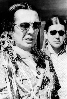 Russell Means, and Clyde Bellecourt, of AIM (American Indian Movement), after being arraigned in Federal Court for AIM's occupation of Wounded Knee. April 16, 1973. CSU Archive/Courtesy Everett Collection