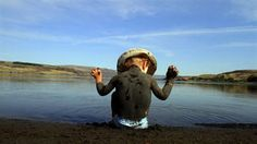 SOAP LAKE, Grant County — After his mother covered him with the lake's mineral-laden black mud, a child sits on the shore of Soap Lake in Eastern Washington. Soap Lake, Mud Race, Lake Photos, West Coast, Racing, Photo And Video, Google Search, Travel, Mineral