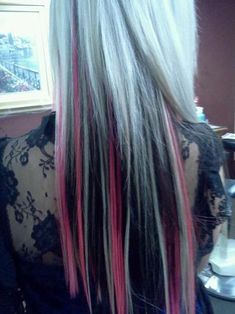 Blonde hair with black and pink highlights. If I were to ever become emo or punk, I would do this hair, because I oddly think it so pretty even though tend to like natural hair.