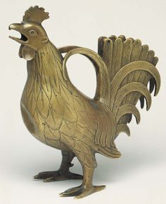 "Aquamanile in the form of a rooster, second half of the 13th century. German; lower Saxony. Latten alloy (copper, tin, and zinc); H. 915/16 in. (25.2 cm). The Metropolitan Museum of Art.  ""An aquamanile is a special pitcher for washing the hands.Often made from copper, brass, or bronze - metals easily shaped by medieval artists— these vessels often contained warm water that had been boiled with orange peel, sage, chamomile, marjoram, rosemary, or bay leaves."""