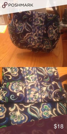 Vera Bradley Mediterranean blue messenger bag. This Vera Bradley messenger bag in Mediterranean blue has 2 pockets on the side and 2 in front, 1 zippered pocket in the back and also 2 slip pockets inside. Was used for a few weeks still in like new condition. No stains tears or rips Vera Bradley Bags