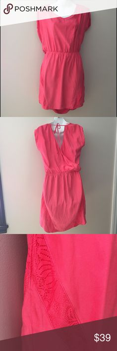 "Express pink silky feel dress. Size small. NWT Express pink silky feel dress with lace accents sides. Size small. Elastic waist. Polyester. 35"" long Express Dresses"