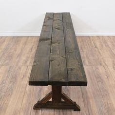 This bench is featured in a solid wood with a distressed dark oak finish. This country style long bench has a wood panel seat, stretcher base and trestle legs. Perfect for a long table! #countryfarmhouse #chairs #bench #sandiegovintage #vintagefurniture