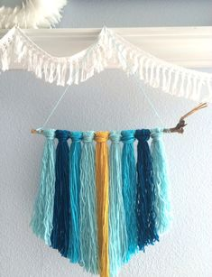 Yarn banner DIY via Art in the Find. In love with these colours!