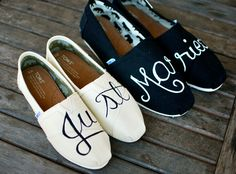 "This pair of custom wedding TOMS shoes says ""Just Married"" in elegant cursive font across the tops of the shoes. The words were painted with water proof permanent acrylic paints that look great and wi"