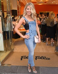 On trend:The Saturdays star sported stylish denim dungarees with skinny bottoms as she ma...