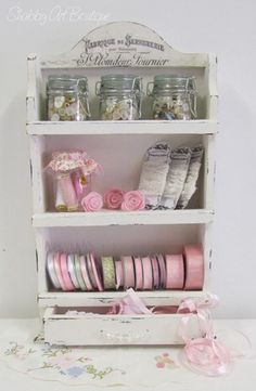 Old spice rack turned ribbon/button storage