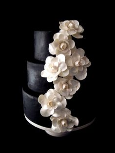 White Gardenias on a Black Wedding Cake. This is cool! I dont know about straight black though...