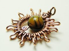 fire agate sun pendant wrapped in copper wire by keoops8 on Etsy, $25.00