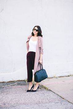 I'm kind of loving this light pink color that is having a total moment this fall. I've seen coats, trenches, jackets — I mean pale pink is everywhere, you guys. I've never been super girly...