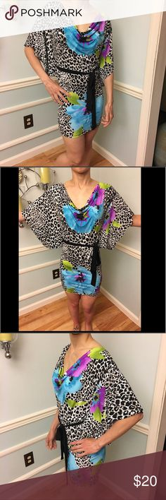 """🌸Trac🌺 floral animal print sexy dress 🌸Trac🌺 floral animal print sexy dress 👗 Cowl neck. Black fabric belt that loops through dress on both sides (can see on 2nd last picture). Model is 5'4"""", waist 25"""", Bust 32B.💖I am in last picture with dress on in Miami 🏝 Trac Dresses Mini"""