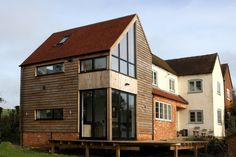 This family in Buckinghamshire extended their living spaces with a double height extension. IQ designed and installed aluminium bi-fold doors, aluminium sliding patio doors, gable end windows and aluminium casement windows Sliding Patio Doors, Casement Windows, House Extensions, Living Spaces, Exterior, Cabin, House Design, Mansions, House Styles