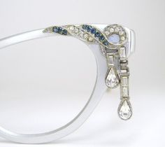 Silver accent with blue and clear rhinestones with unique tear drop rhinestone that dangle. (Etsy) Vintage 50s Eyewear <3