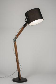 Artikel 72078 Waanzinnige vloerlamp! Deze vloerlamp bestaat uit diverse materialen; metaal, hout, aluminium, chroom, stof, en kunststof. Een unieke combinatie waardoor een geheel eigen karakter is ontstaan; stoer, eigenwijs maar zeker elegant! http://www.rietveldlicht.nl/artikel/vloerlamp-72078-retro-aluminium-chroom-hout-kunststof-metaal-stof-meerkleurig-zwart-mat-rond