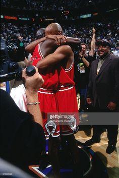 Michael Jordan #23 and Ron Harper #9 of the Chicago Bulls celebrate after winning the 1998 NBA Championship against the Utah Jazz on June 14, 1998 in Salt Lake City, Utah.