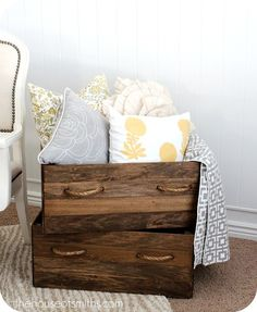 DIY Vintage Crates- Also love the idea of having somewhere to put throws and extra pillows.