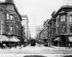 (ca. 1900)^ - The 234 Santa Monica/Venice streetcar is running east on 4th St. in this view of commercial, downtown Los Angeles at Hill and 4th. The Hotel Clarendon is on the southeast corner, a cigar store on the bottom floor. The Grant Building is on the center left. Deliveries are being made by horse-drawn wagons. An awning advertises ice cream sodas for 5 cents. Water and Power Associates