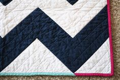 sample ideas for chevron navy white quilt...like the stripes on the back, but in different colors.  Also like the simple quilting pattern.