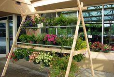 Image result for hanging basket display stand Hanging Basket Stand, Hanging Flower Baskets, Container Plants, Container Gardening, Garden Center Displays, Garden Centre, Diy Hanging Planter, Greenhouse Gardening, Greenhouse Ideas