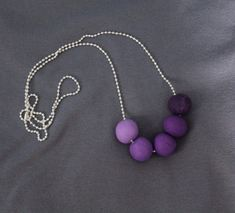 Polymer clay necklace in variations of Purple Ombre by HammeredandFired on Etsy https://www.etsy.com/au/listing/516587843/polymer-clay-necklace-in-variations-of