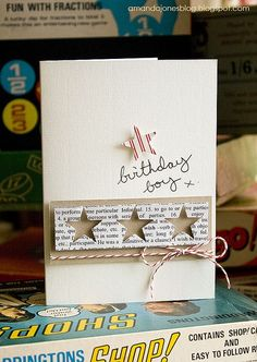 handmade birthday card ... boy ... like the popped layer of book paper with negative space die cut stars ...