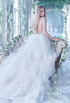 Alvina Valenta. Antique tulle bridal ball gown with a sheer embroidered v neckline and low back. Thin satin ribbon at the natural waist and a horsehair edged flounce skirt with sparkle throughout.