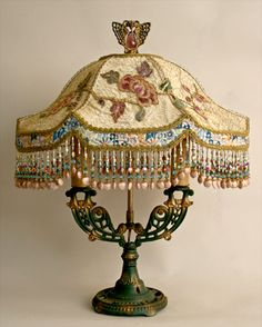 1920s era antique table lamp with original paint finish holds an ivory Chinoiserie inspired Peony & Butterfly lampshade.