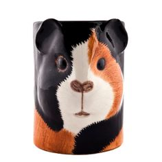 Quail Ceramics Guinea Pig Pen Pot: This cute ceramic Guinea Pig Pen Pot is sure to make your desk or workspace instantly cuter and bring a smile to all who pass by.  Designed by Quail Ceramics.