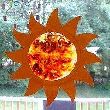 This is a sun catcher made from crayon shavings that are eventually melted by the sun. It is a great activity to show weather, temperature, reflection, etc. You could also put a thermometer on the window to observe what temperature melts the crayons the best.
