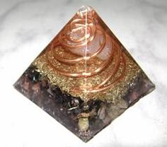 This is one of our Chilean Orgone Pyramids. It is three sided and made of metal shavings, coper coils and crystals!