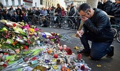 The Paris Attacks: Making Sense of A Night of Terror. Members of the public gather to lay flowers and light candles at La Belle Equipe restaraunt on Rue de Charonne following Fridays terrorist attack on November 15, 2015 in Paris, France. AUDIO
