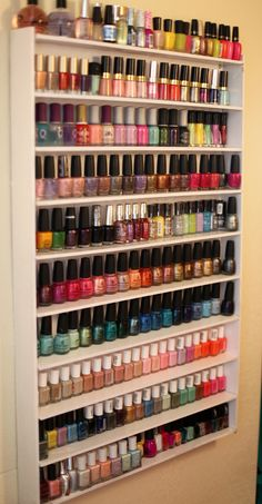 "AWESOME!! DIY Nail Polish Rack  You will need:   10- 2.5″x 2FT boards   2- 2.5″x 36″ boards   1- 24.5″x 36 back board   1 can of Ultra Cover Gloss white spray paint (Painter's Touch)   Gorilla Glue -""For The Toughest Jobs On Planet Earth""   Plastic anchors   Hot glue gun and glue sticks   Pencil   Ruler"