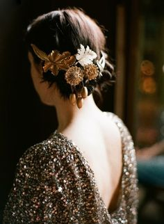 A lovely updo for an Autumn wedding using vintage brooches with an autumn motif