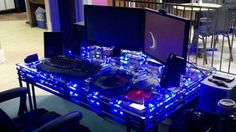 Love the idea of the computer built into the desk, and lots of cooling.  I think I would prefer an opaque top though with just the glow around the edges.