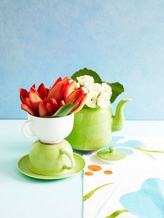 Great idea for non-used teapots and cups!  This is really cute for spring, add some non slip material inbetween cups in order to ensure a non-permanent but sturdy adhesion.