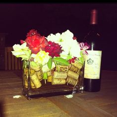 Dinner table arrangement for our dinner party last night! Wine corks and flowers floating in vase!