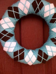Stop it!  This is too cute!  Argyle yarn wreath!  Consider this one done and hung!
