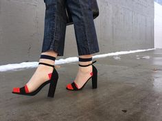 Pop of red outfit, flare out jeans, sheer socks, color block socks, tulle socks, block heel sandals, black sandals,