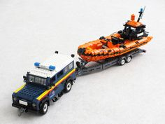 The Royal National Lifeboat Institution (RNLI) is a UK volunteer-run organisation for sea rescue. The RNLI uses Land Rover Defenders, among other vehicle, to pull their boat trailers. I built the Land Rover more two years ago together with Ed Diment Lego Truck, Toy Trucks, Lego Police Car, Lego Coast Guard, Lego Kai, Lego Fire, Lego Knights, Lego Military, Lego Army