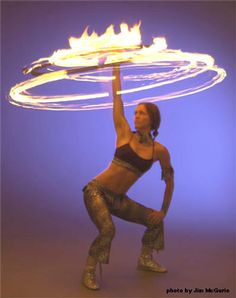 Vivian Hancock, who performs as Spiral, with her fire hoop.  I learned to hoop, and to fire hoop, from her.