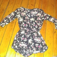 Wet seal short romper Floral long sleeve romper with button accent in the front. Great condition. Worn once Wet Seal Pants Jumpsuits & Rompers